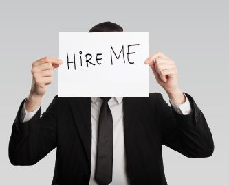 interview techniques, hire me, man with hire me sign